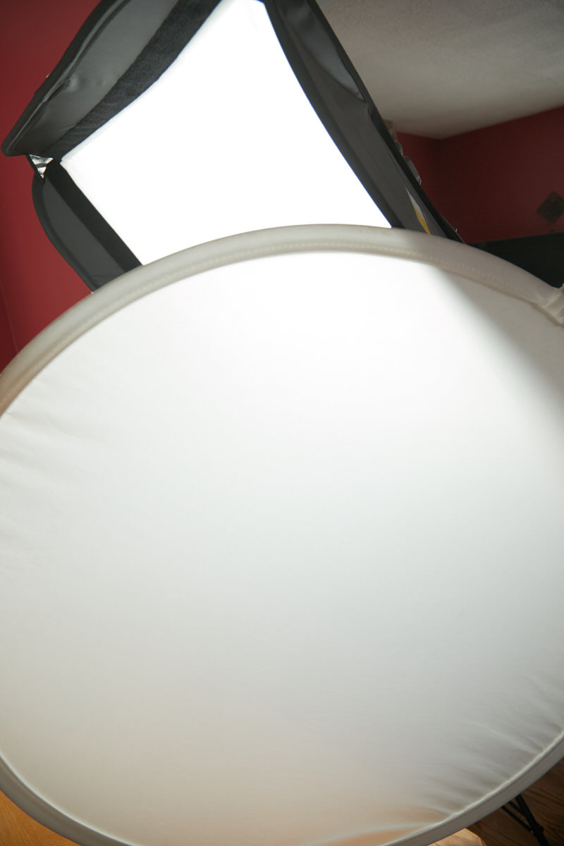 A diffusor in front of a flash with a softbox.