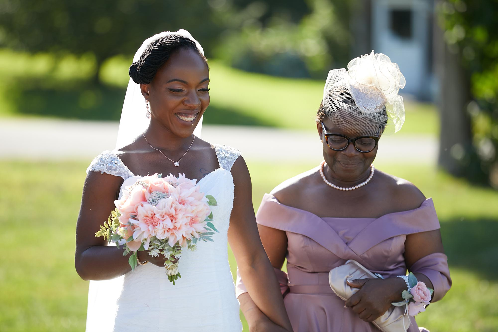 A bride walking down the isle with her mother.